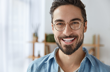Man with Glasses Smiling with White Teeth