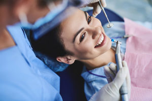 woman smiling during fluoride treatments in TX