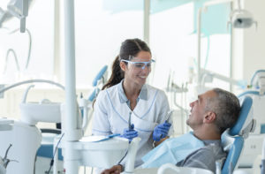 Dr. prepares patient for a root canal