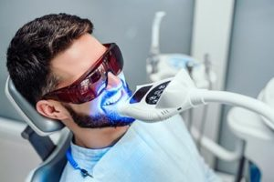 man getting teeth whitening services