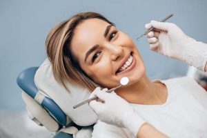 woman visiting a speciality dentist and learning about speciality dentistry services
